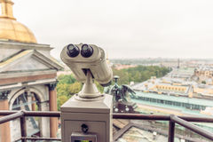 Binoculars on the observation deck on the roof of St. Isaac`s Cathedral in St. Petersburg. Toned Stock Photo