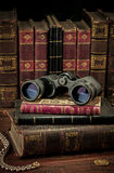 Binoculars and old books Royalty Free Stock Image