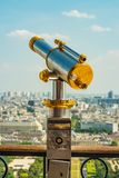 Binoculars On The Second Floor Of The Eiffel Tower Watching Over Park Champs De Mars. Royalty Free Stock Images