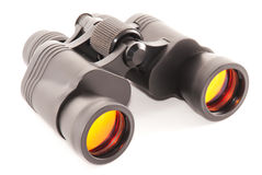 Binoculars with orange lenses. Isolated on a white background Stock Photo