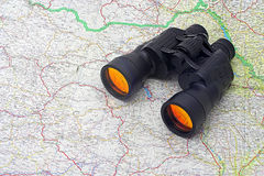 Binoculars over the map. Of the world Royalty Free Stock Image