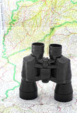 Binoculars over the map. Of the world Stock Photos