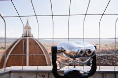 Binoculars overlooking cityscape Royalty Free Stock Image