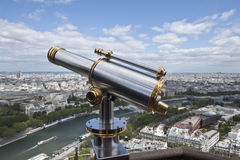 Binoculars overlooking panorama of Paris Stock Photography