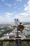 Binoculars overlooking panorama of Paris Royalty Free Stock Image
