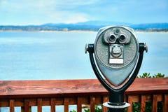 Paid binocular. With coastal view stock image