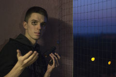Binoculars prank. Picture of prank with binoculars, the young man was bamboozled, old hoax Stock Photo