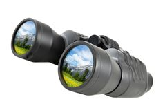 Binoculars reflect beautiful landscape Stock Images