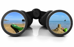 Binoculars Reflecting beach Royalty Free Stock Photos