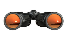 Binoculars with reflection of sunset in lenses Stock Images