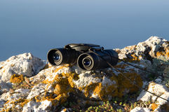 Binoculars on the rock Royalty Free Stock Photos