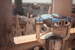 Binoculars on the roof of Duomo in Milan, Italy. Top view to the city, Sunny day Stock Image