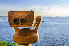Binoculars on the roof to the sea Royalty Free Stock Photography