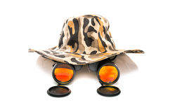 Binoculars and a safari hat. On a white background conceptual of travel, adventure and eco-tourism or a wildlife safari stock photo