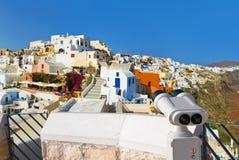 Binoculars and Santorini view (Oia), Greece Royalty Free Stock Photos