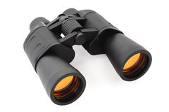 Binoculars for searching on white. Background; orange reflection in lens Royalty Free Stock Images