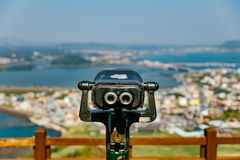 Binoculars of Seongsan Ilchulbong. Seongsan Ilchulbong, also called 'Sunrise Peak', is an archetypal tuff cone formed by hydrovolcanic eruptions upon a Stock Photos
