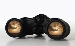 Binoculars showing distant sunset. Abstract view of a rosy sunset future through binocular lenses stock images