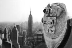 Binoculars skyscraper Stock Image