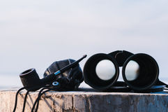 Binoculars on the stump Royalty Free Stock Photography
