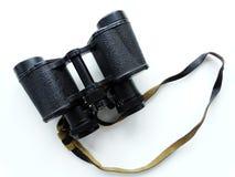 Binoculars on a table. Lenses zoom optics Royalty Free Stock Photography
