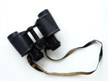 Binoculars on a table. Lenses zoom optics Royalty Free Stock Photo