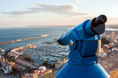 Binoculars telescope overlooking Alicante harbor Royalty Free Stock Photos