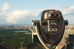 Binoculars telescope overlooking Central Park Royalty Free Stock Images