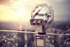 Binoculars or telescope on top of scyscraper at observation deck Royalty Free Stock Photography