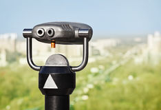 Binoculars to observe green city. From a height Royalty Free Stock Photography
