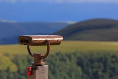 Binoculars on a viewing platform for observing flora, fauna. And landscape royalty free stock image