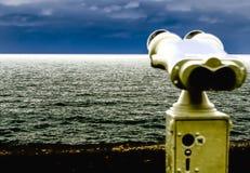 Binoculars, watching the skyline III Stock Images