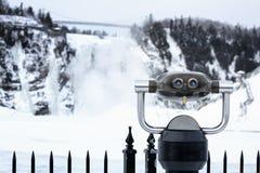 Binoculars and waterfall Stock Image