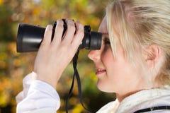 Binoculars woman Stock Photos
