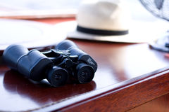 Binoculars on wood table Royalty Free Stock Photo
