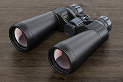 Binoculars on the wooden table, 3D. Rendering Royalty Free Stock Images