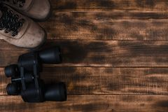 Binoculars on the wooden table stock photography