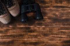 Binoculars on the wooden table royalty free stock photography