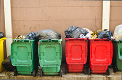 The bins. Colourful bins with full stack of junk Royalty Free Stock Images