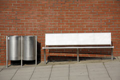 Bins, Bench and Wall. Stainless Steel street furniture against a red brick wall Stock Photography