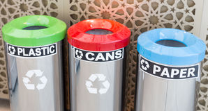 Bins for garbage seperation. Three bins for garbage seperation, plastic, cans, paper stock photo