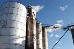 Bins of Grain Elevator. Horizontal view of bins of grain elevator in rural midwestern town on bright sunny day stock image