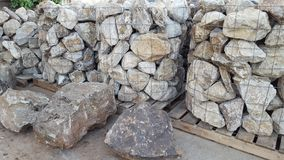 Large rocks for landscaping. Bins of large rocks at a building supply store Royalty Free Stock Photos