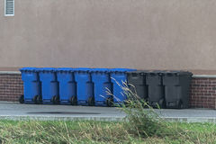 Bins. Recycling bins against a wall Royalty Free Stock Images