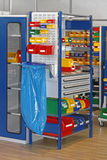 Bins and Trays. Colourful Plastic Bins and Trays in Storage Room Royalty Free Stock Photography