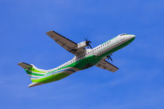 Binter Canarias aircraft take-off. A Binter Canarias ATR 72-600 takes off under blue skies Royalty Free Stock Photo
