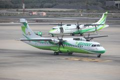 Binter Canarias. GRAN CANARIA, SPAIN - DECEMBER 7, 2015: Two Binter Canarias ATR 72 aircraft taxi at Las Palmas Airport in Gran Canaria, Spain. Binter Canarias Stock Image