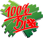 Bio_100_percent_brushstroke. Hand written 100 percent bio including a four-leaf clover over some green brushstrokes Royalty Free Stock Images