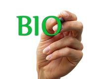 BIO. Hand and the word bio. isolated on white background Royalty Free Stock Image
