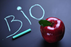 Bio. Red apple and bio text on blackboard, close up Stock Images